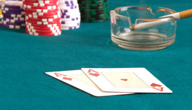 Two ases on cloth. Hearts and as of diamonds on a table for game in poker Royalty Free Stock Photo