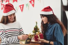 Two asia woman surprise when open gold gift box at holiday party Royalty Free Stock Photo