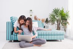 Two asia woman using laptop computer to shopping online and sitt Royalty Free Stock Photos