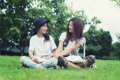 Two asia young girl with bag on park Royalty Free Stock Image
