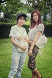 Two asia young girl with bag on park Stock Photography