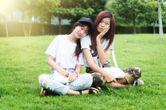 Two asia young girl with bag on park Stock Image