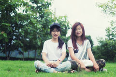 Two asia young girl with bag on park Stock Images