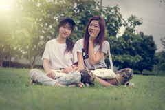 Two asia young girl with bag on park stock photos