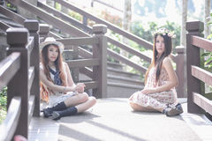 Two asia young women sitting on terrace Royalty Free Stock Images