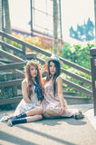 Two asia young women sitting on terrace Stock Images