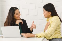 Two Asian architect ladies at office stock image