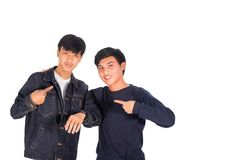 Two Asian boys are pointing to themselves. Two Asian boys are pointing to themselves white background Royalty Free Stock Images