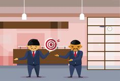 Two Asian Business Men Holding Target With Arrow In Center In Modern Office Businessmen Cooperation And Achievement Stock Photos