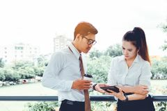 Two asian business people working together on digital tablet at Royalty Free Stock Photos