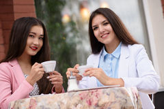 Two Asian business woman in brasserie and Looking Stock Photography