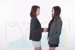 Two asian business woman double exposure with business graph Royalty Free Stock Image