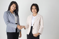 Two asian Business women Shaking Hands Royalty Free Stock Images