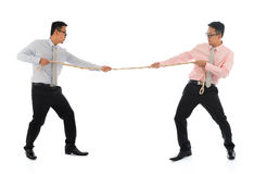 Two Asian businessmen pulling a rope Royalty Free Stock Images