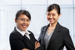 Two Asian businesswoman in office Stock Image