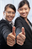 Two Asian businesswoman with thumbs up Stock Images