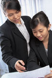 Two Asian businesswomen Royalty Free Stock Image