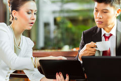 Two Asian Chinese business people Stock Images