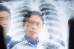 Two Asian doctor examining xray result Royalty Free Stock Photography