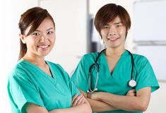 Two Asian doctors wearing green Scrubs Stock Images