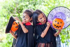 Two asian girls in halloween costumes and makeup having fun on Halloween celebration