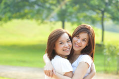 Two Asian girls having fun stock photos