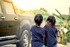 Two asian girls helping parent washing a car Royalty Free Stock Photos