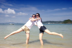 Two asian girls hug on the phuket beach Royalty Free Stock Photo