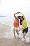 Two Asian girls taking exercise at Phuket beach Stock Image
