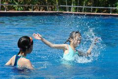 Two Asian kids playing in swimming Royalty Free Stock Photos