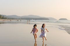 Two Asian kids running on beach Stock Photography