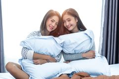 Two Asian Lesbian in bedroom. Beauty concept. Happy lifestyles and home sweet home theme. Cushion pillow element and window. Background stock image
