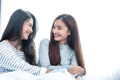Two Asian Lesbian women in bedroom. Couple people and Beauty concept. Happy lifestyles and home sweet home theme. Cushion pillow. Element and window background royalty free stock photography