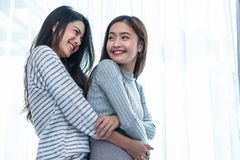 Two Asian Lesbian women hug and embracing together in bedroom. Couple people and Beauty concept. Happy lifestyles and home sweet royalty free stock photo