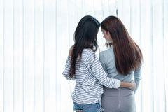 Two Asian Lesbian women looking together in bedroom. Couple people and Beauty concept. Happy lifestyles and home sweet home theme. Embracing of homosexual royalty free stock image