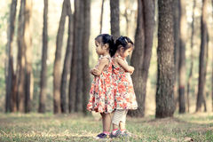 Two asian little girls hug their chest Stock Photography