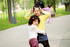 Two Asian little girls outdoor Royalty Free Stock Photography