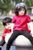 Two Asian little girls outdoors. royalty free stock photography