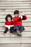 Two Asian little girls on stairs. royalty free stock photo