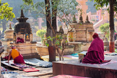 Two asian men thinking and meditating in a historic park of the buddhist temple Royalty Free Stock Images