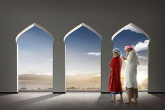 Two asian muslim man praying together stock images