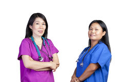 Two Asian nurses on white background Stock Image