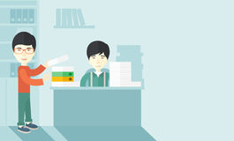 Two asian office clerk inside the office Royalty Free Stock Images