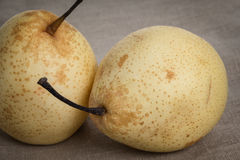 Two asian pears on burlap Royalty Free Stock Photo