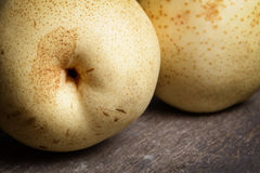 Two asian pears on old wooden table Stock Image