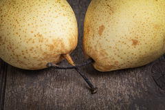 Two asian pears on old wooden table Royalty Free Stock Photos