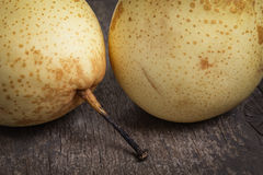 Two asian pears on old wooden table Stock Photo