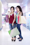 Two asian people with shopping bags Stock Image
