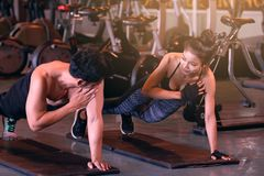 Two asian people sporty put your hands on the floor and hold the. Shoulder for fitness workout royalty free stock images