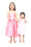 Two asian preschool girls holding thumbs up Stock Photos